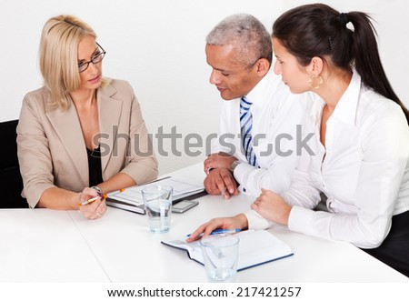 Business consultatant advising business people in the meeting - stock photo