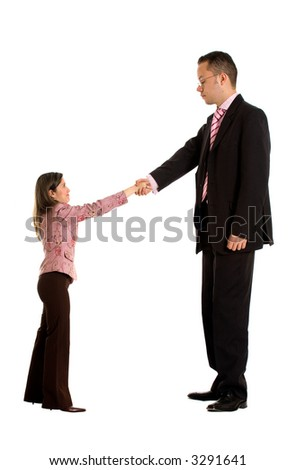 business couple doing a handshake where the businessman is a lot bigger than the businesswoman - good concept for merging companies - isolated over a white background - stock photo