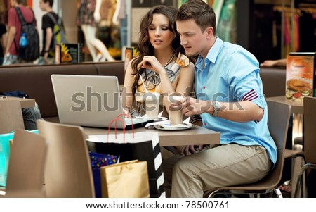 Business couple having lunch - stock photo