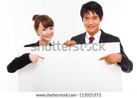 Business couple holding a add banner. - stock photo
