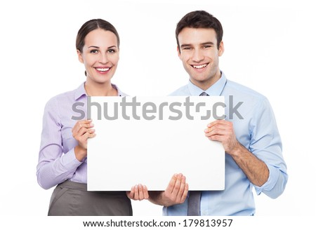 Business couple holding a placard - stock photo