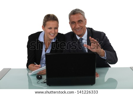 Business couple laughing - stock photo