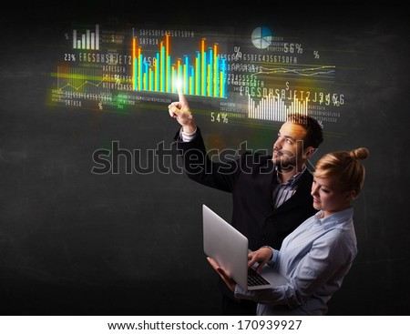 Business couple touching colorful charts and diagrams  - stock photo