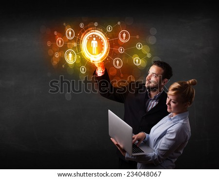 Business couple touching future technology social network button  - stock photo