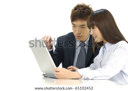 business couple with laptop - stock photo