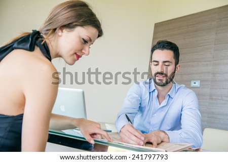 Business Couple Working at Office - stock photo
