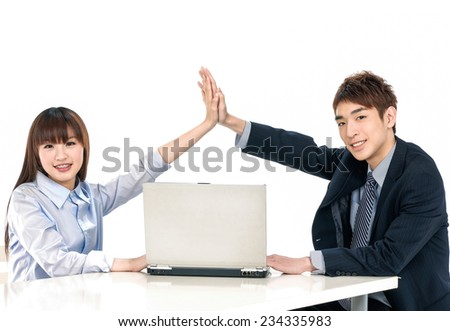 Business Couple working at office, smiling - stock photo