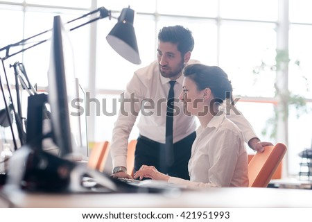 business couple working together on project at modern startup office - stock photo