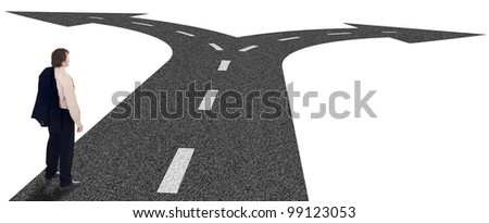 Business crossroads - decisions and strategic planning concept with businessman and forking road - stock photo
