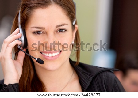 business customer operator smiling in an office - stock photo