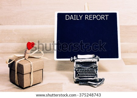 business  daily report blank list memo written on a blackboard with typewriter - stock photo