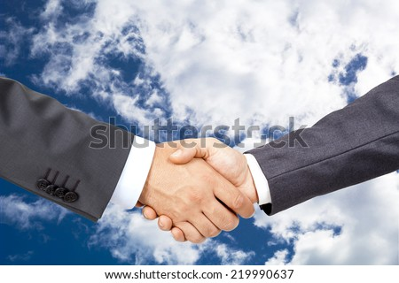 Business deal with sky backgraund - stock photo
