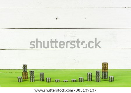 Business diagram on financial report with coins. Saving money concept. money coin stack growing business - stock photo