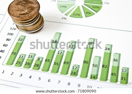 Business diagram with stack of coins. Studio shot - stock photo