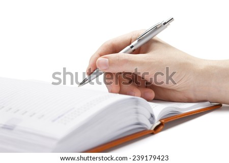 Business diary with a pen on a white background - stock photo