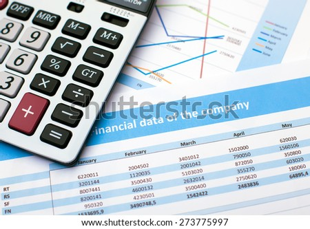 Business document. Calculator. Financial data of the company - stock photo