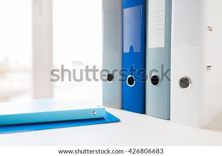 business, document, paperwork, office supply and education concept - close up of ring binders and files on table - stock photo