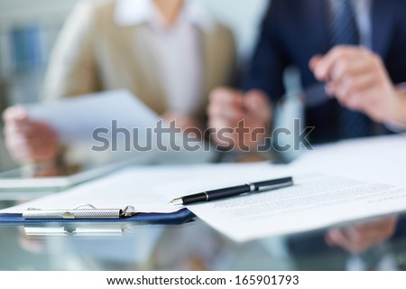 Business documents and pen at workplace - stock photo