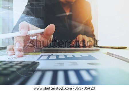 business documents on office table with digital tablet computer with smart phone and graph business digital diagram and businessman working in the background - stock photo