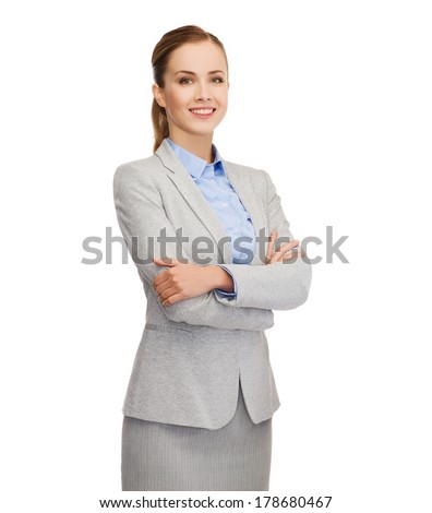 business, education and office concept - smiling businesswoman standing - stock photo