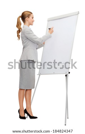 business, education and office concept - smiling businesswoman writing on flip board - stock photo