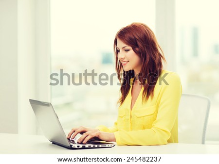 business, education and technology concept - smiling student with book laptop computer at school - stock photo
