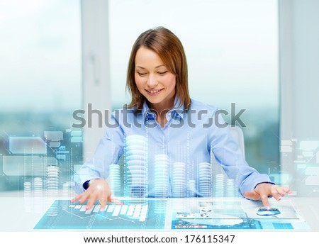 business, education and technology concept - smiling woman pointing to buttons on virtual screen - stock photo