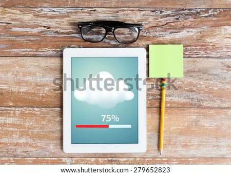 business, education, objects and technology concept - close up of tablet pc transferring data, eyeglasses and stickers with pencil on table - stock photo