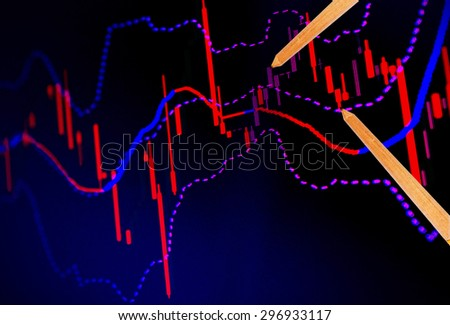 Business education, pencil drawing a graph. - stock photo