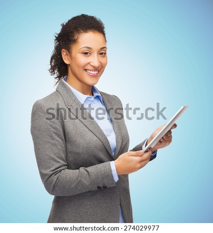 business, education, people and technology concept - smiling african american woman holding tablet pc computer over blue background - stock photo