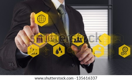 business engineer hand works industry diagram on virtual computer as concept - stock photo