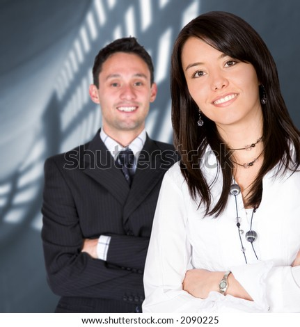 business entrepreneurs with a corporate background - focus is on the girl - stock photo