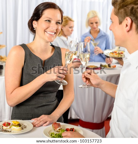 Business event two colleagues celebrate toast drink enjoy catering buffet - stock photo