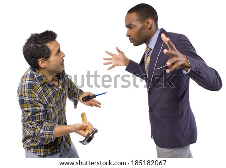 business executive being bossy to a blue collar worker - stock photo