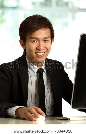 Business executive in corporate setting working at a desk - stock photo