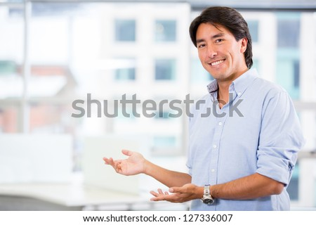 Business executive welcoming people to the business - stock photo