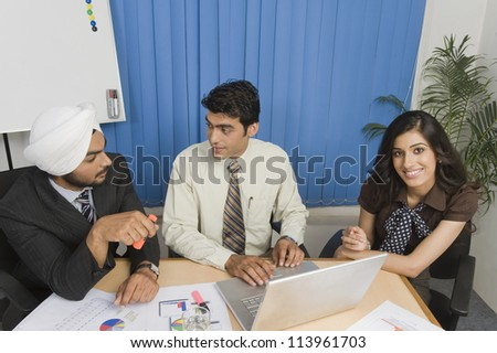 Business executives are on meeting in an office - stock photo