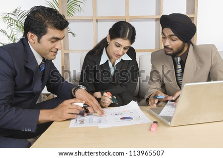Business executives discussing in a meeting - stock photo
