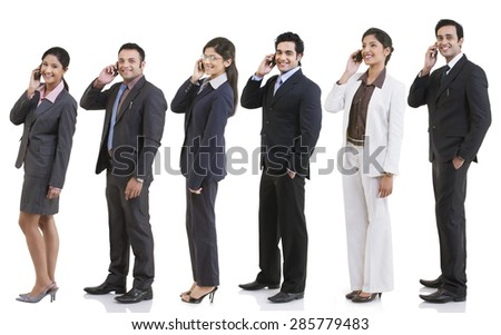 Business executives talking on a mobile phone - stock photo