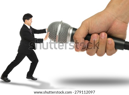 Business fear to speak and pusk microphone back ,no need to say. - stock photo