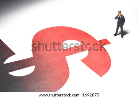Business figures and dollar sign - stock photo