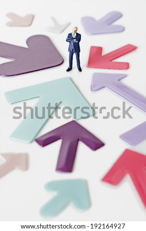 Business figurine with arrows - stock photo