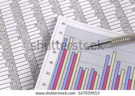 business finance chart with data and pen - stock photo