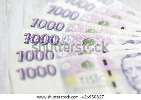 business, finance, saving and cash concept - close up of czech paper money  on table - stock photo
