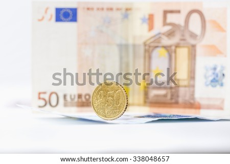 business, finance, saving and cash concept - close up of euro paper money and coins on table, selective focused - stock photo