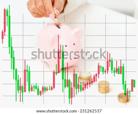 business, finances, crisis, people and money saving concept - close up of graph and female hand putting euro coins into piggy bank - stock photo