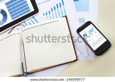 business financial chart and graph report display in mobile devices - stock photo