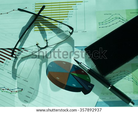 Business financial charts and graphs on the table. - stock photo