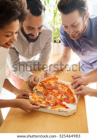 business, food, lunch and people concept - happy business team eating pizza in office - stock photo