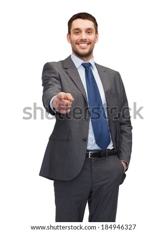 business, gesture and office concept - handsome buisnessman pointing finger at you - stock photo